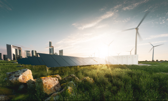 Shot of wind turbines next to solar panels