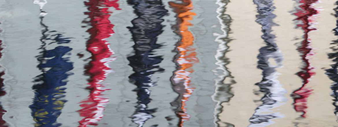 Colored flags with a reflection of the Repsol logo