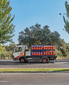 A Repsol butane gas delivery truck on the road