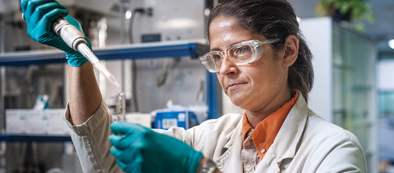 A researcher in the chemicals lab of a refinery