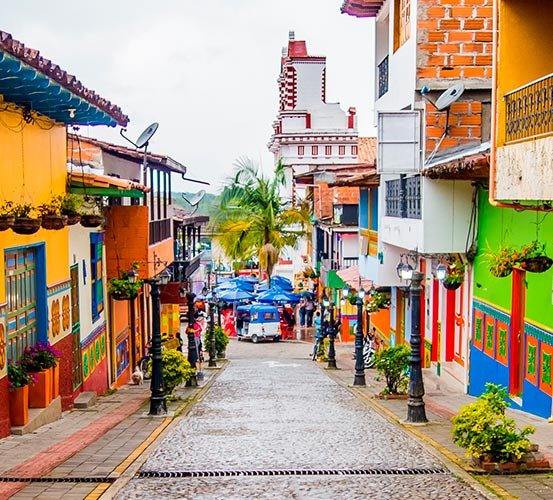 View of a colorful street in Colombia. Sustainability - Success Stories.