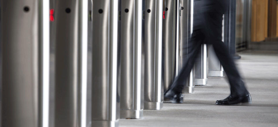 Close-up of the turnstiles at the Repsol Campus as someone is walking through them