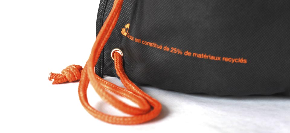 Close-up of a black and orange bag made in part with recycled materials