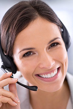 A customer service representative smiling at the camera with a headset on