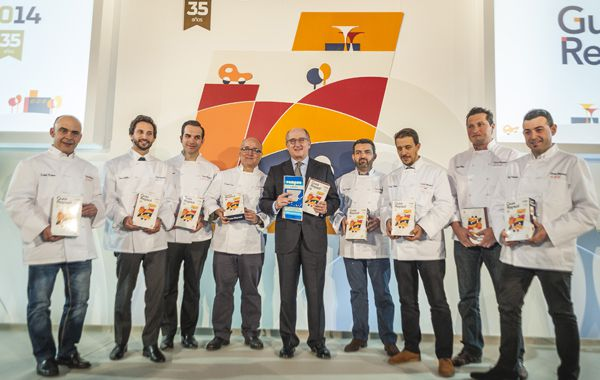 Repsol Chariman Antonio Brufau with renowned chefs posing with the Repsol Guide celebrating its 35th anniversary