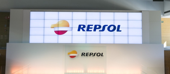 Shot of of a screen in the campus auditorium showing the Repsol logo