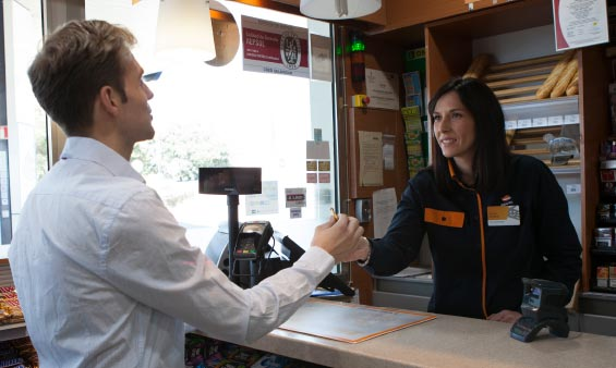 A Repsol employee helping out a customer