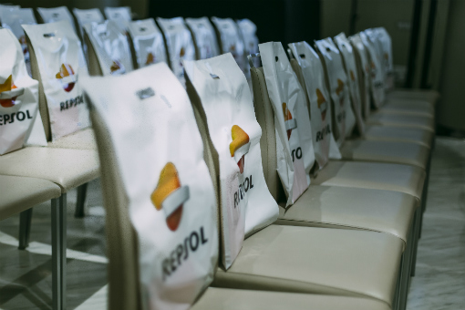 Rows of seats with Repsol goodie bags awaiting their occupants.