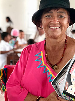 A woman from the local community at a school.